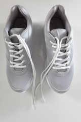gray sneakers with laces