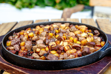 The Azerbaijan cuisine. Fried potatoes with meat and liver