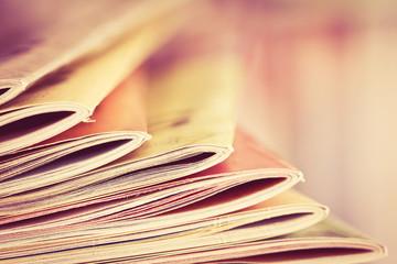 Close up edge of colorful magazine stacking