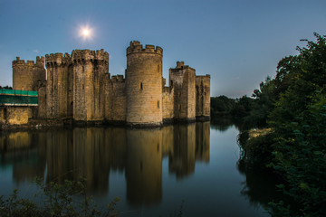 Bodium castle and moat under moonlight