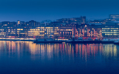 Aker Brygge - downtown Oslo - in the evening's twilight.