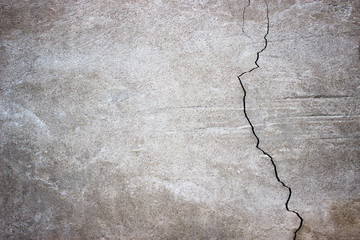 cracked concrete wall covered with gray cement surface as backgr