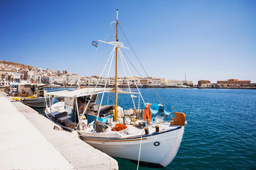 Beautiful fishing boats with view at greek town Ermoupoli, Syros island, Cyclades, Greece