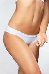 Period. Close Up Of Woman Slim Body In Panties Holding Tampon