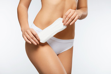 Closeup Beautiful Female Body In Panties Holding Sanitary Napkin