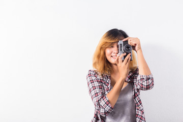 Young beautiful hipster woman with an old retro camera.