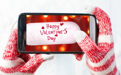 taking a photo of Valentines day card