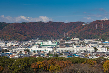 Himaji city downtown view from Himaji Castel with mountain background during Authum season