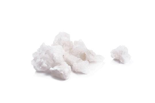 Organic sea white salt tablets ioslated on white background.