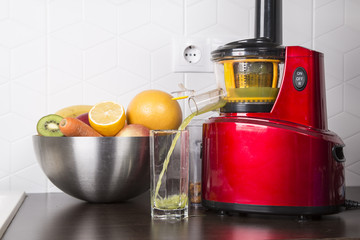 juicing fresh beautiful bright vegetables and fruits