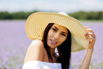 Happy woman in summer field. Young girl relax outdoors. Freedom concept.