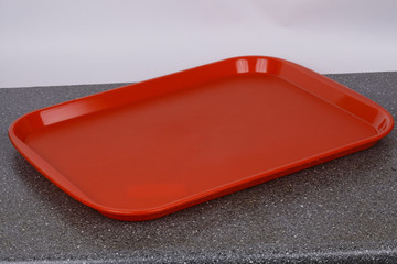 Red plastic table tray