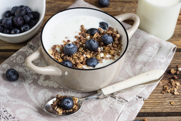 Healthy breakfast with yogurt, granola and fresh blueberry.