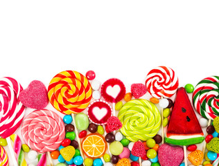 Fototapete - Colorful candies and lollipops. Top view.