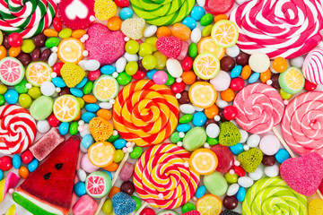 Garden Poster Candy Colorful lollipops and different colored round candy.