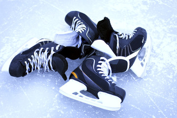 Skates for hockey on the outdoor ice winter.