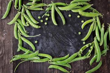 Green Peas on Black Background