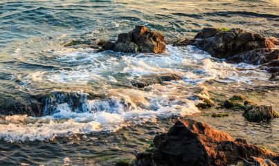 wave rolls onto the rocky coast