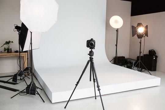 Photo studio with lighting equipment and digital camera