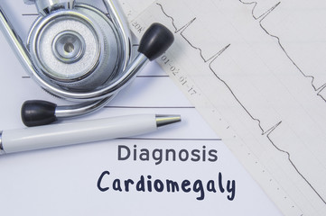 Diagnosis of cardiomegaly. Stethoscope, printed electrocardiogram and pen are on paper medical form where indicated cardiological diagnosis Cardiomegaly. Concept for Internal Medicine or Cardiology