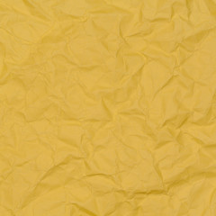 abstract background of crumpled yellow paper