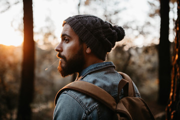 Man looking back in autumn forest