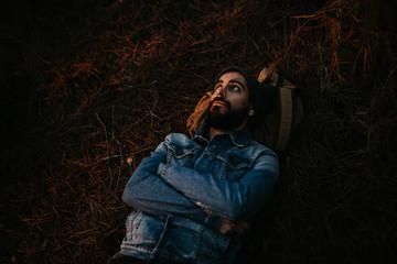 Man lying in woods