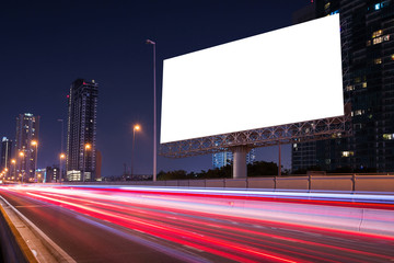 city life in the night with big blank billboard