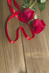 Roses and Ribbon on top of the wood heart shaped