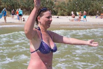 woman having fun while swimming in the lake