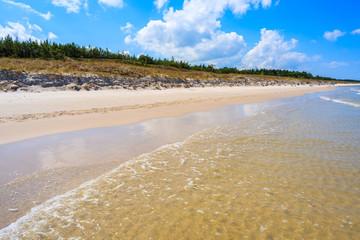 Sea waves on beautiful Lubiatowo beach on coast of Baltic Sea, Poland