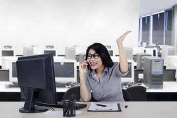 Cheerful businesswoman talking on smartphone