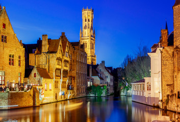 Wall Murals Bridges Bruges. City canal in night lighting.