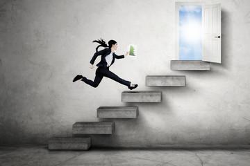 Female entrepreneur runs toward door