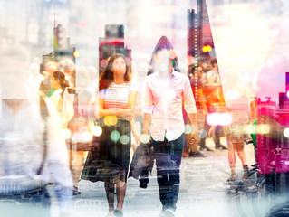 Silhouettes of young couple walking in London against of sunset. Multiple exposure image. Romantic concept illustration.