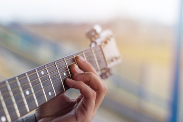 Close-up of men playing acoustic guitar