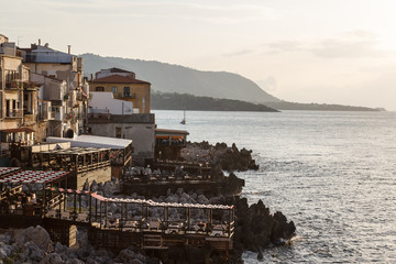 Restaurants on the coast in Cefalu in the evening light, Sicily