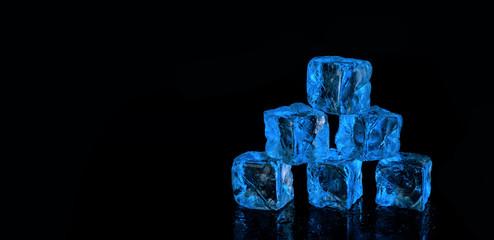 six blue ice cubes on black background