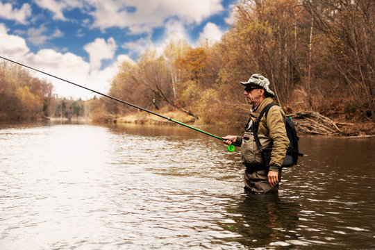 Grayling fishing on the river in autumn