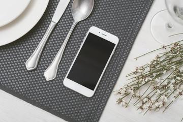 Smartphone mockup in restaurant