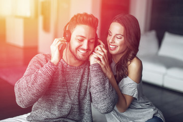 Young couple listening music indoor