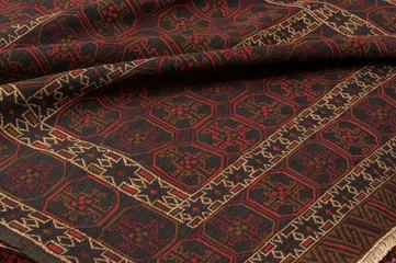 Close up of a hand woven afghan Adraskand kilim rug