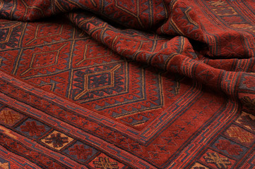 Close up of a hand woven and knotted afghan berjesta mashwani kilim rug