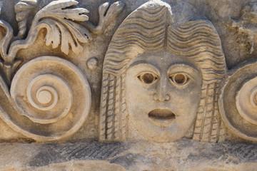 Carved Greek masks
