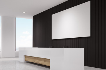 Side view of a reception desk against black wall