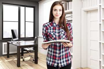 Girl in home library with a desk