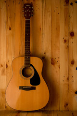 acoustic guitar on wood. background,still life