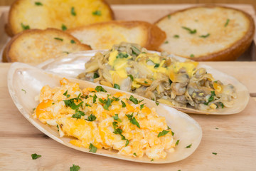 omelets with Butter clams on shell and bread Serving style