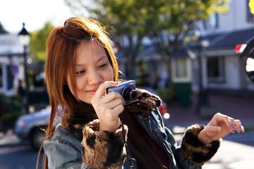 Asian long hair girl taking photo with camera