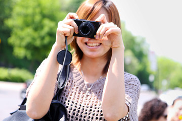 Asian short hair girl taking photo with camera